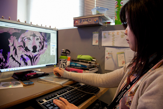 Manage other designers: Working designer at keyboard