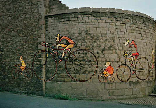 orange street art: bikes