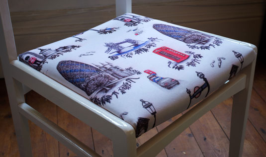 Real London print on chair cushion, by Nicola Toon