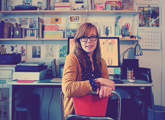 Lydia Nicholls at desk
