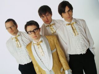 Weezer with Mikey Welsh second from right in 2001