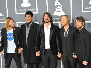 Foo Fighters display a united front on arrival at the 54th Grammy Awards ceremony