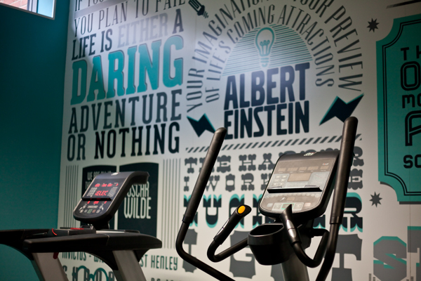 Typographic mural provides inspiration for gym goers for Phrases murales