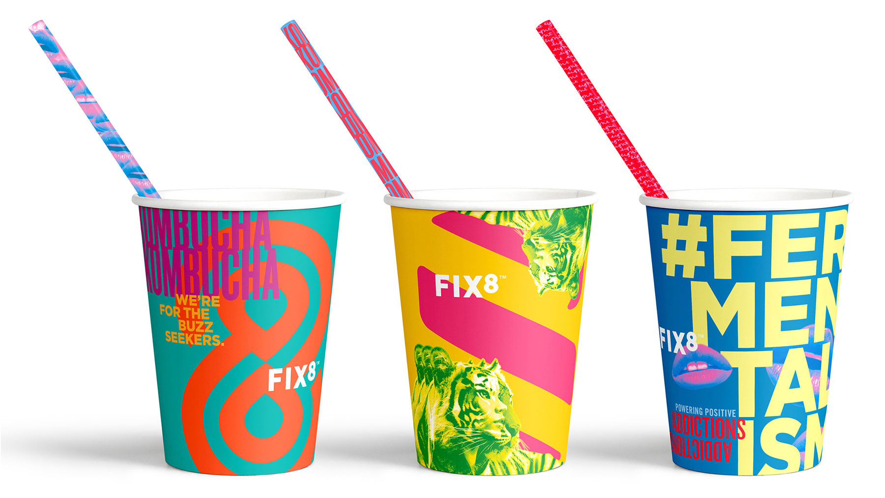 three brightly coloured cups with straws