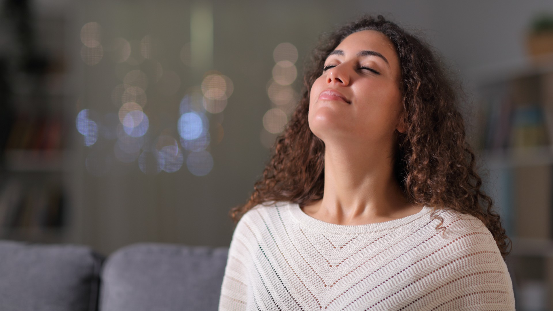 Woman on sofa breathing deeply