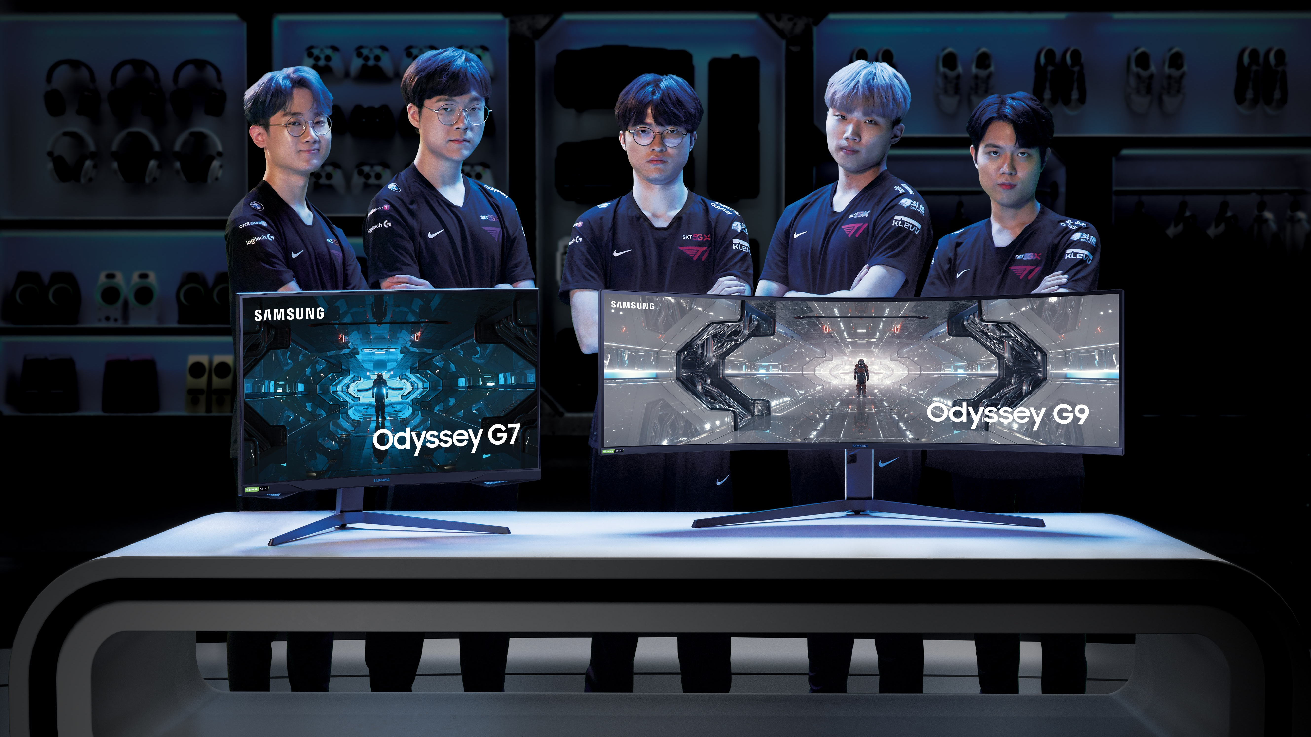 T1 League of Legends Team: 'Effort' Sangho Lee, 'Teddy' Jinsung Park, 'Faker' Sanghyeok Lee, 'Canna' Changdong Kim, 'Cuzz' Uchan Mun with Samsung Odyssey Monitors