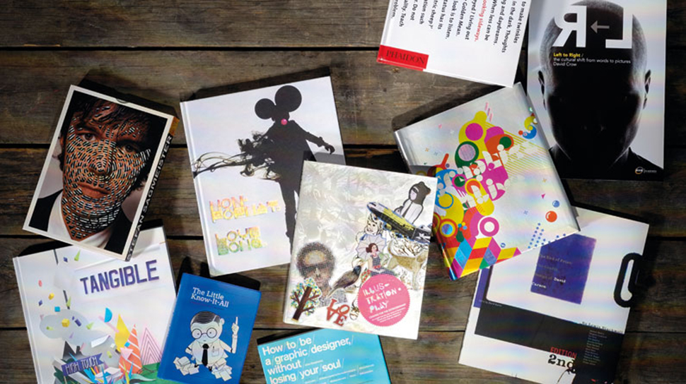 Various books on graphic design laid out on a table