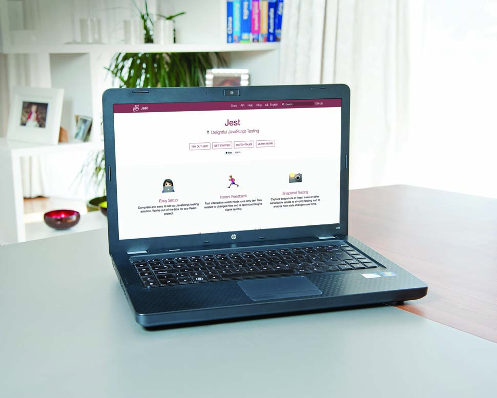 laptop on table with Jest website opened