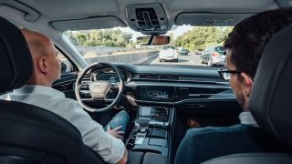 Look, no hands! New Audi A8 lets you sit back and relax in traffic jams