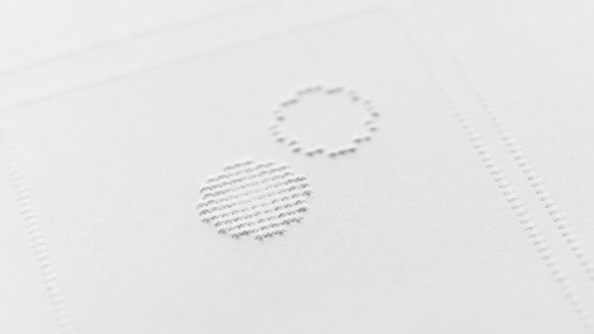 Two simple shapes in the braille comic close up