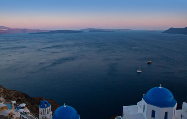 The view from Santorini — with a perfect sky