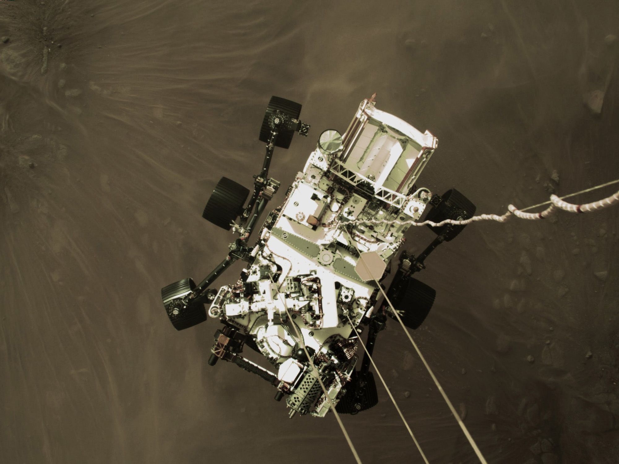 Wow! See the Perseverance rover dangling above Mars in this amazing landing photo