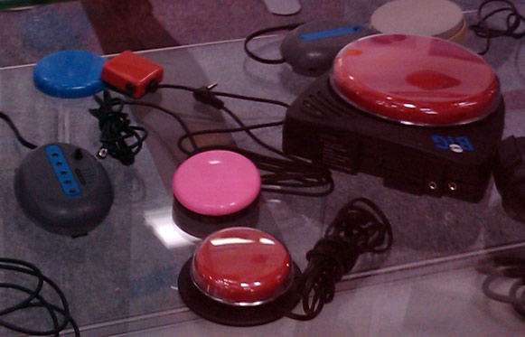 Various switch input devices, plastic buttons in various sizes and colours