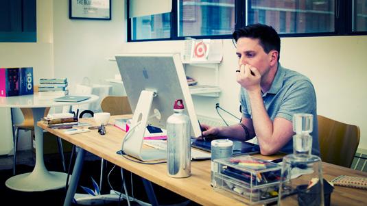 Joe Stewart at his desk