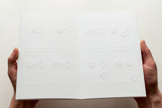 A double page spread of the braille comic
