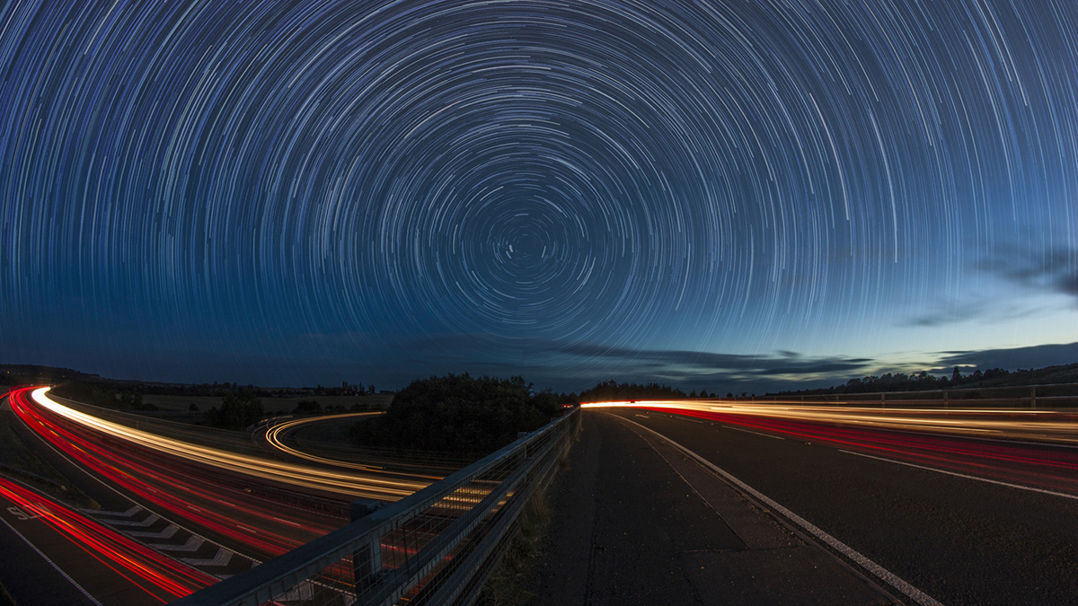 Star trails over a busy road