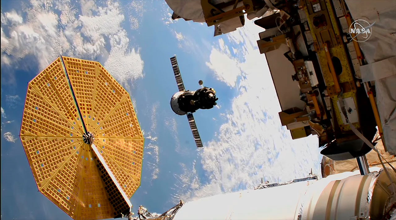 Space station crew moves Soyuz spacecraft to new parking spot ahead of new arrivals
