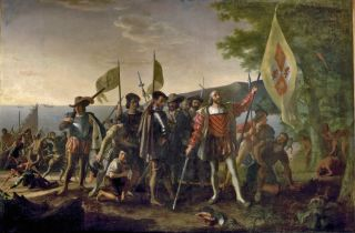 A painting shows Columbus landing in what he called the West Indies in 1492.