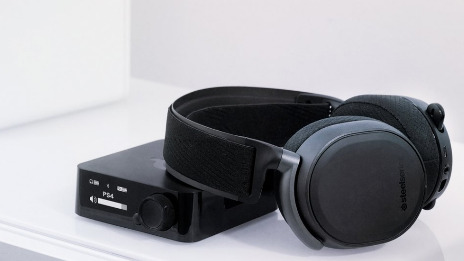 SteelSeries Arctis Pro Wireless headphones on top of PS4