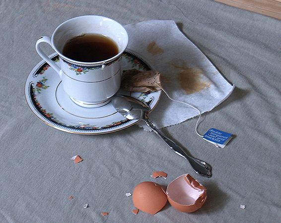 Reference images: photo of a teacup with a broken egg