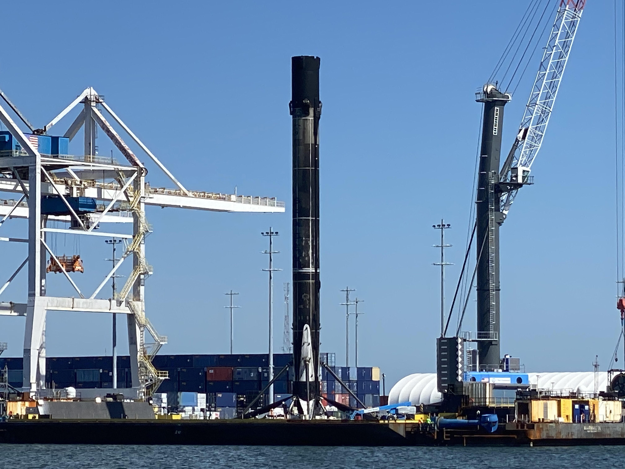 See SpaceX's most-flown rocket returns to home port after 9th flight (photos)
