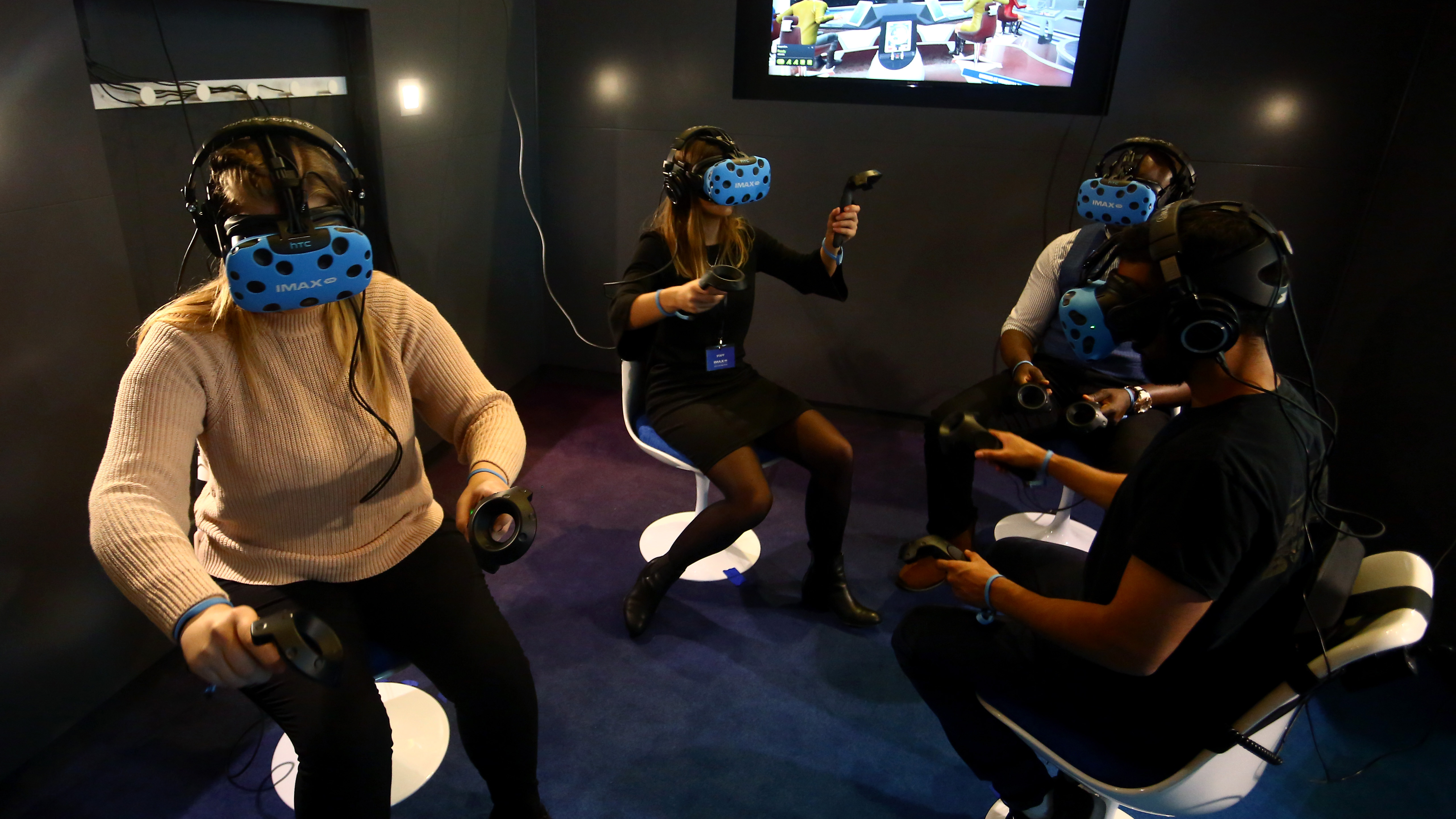 Four people playing a VR game