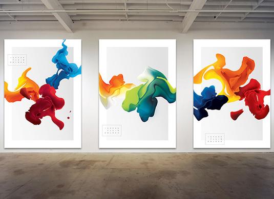Swirls of colours across three white backdrops