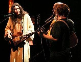 John sees the guitar as a religious calling...
