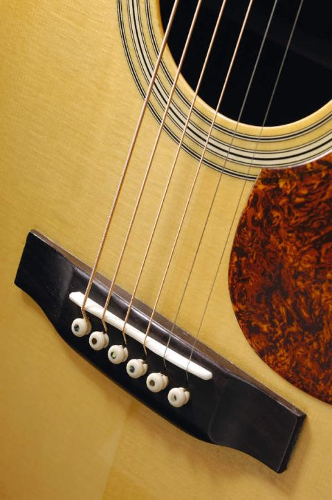 The RD27's rosewood bridge adds to its classy, understated looks.