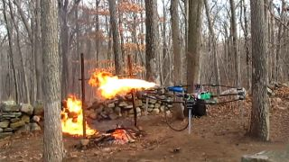 A drone equipped with a flamethrower sets fire to a holiday turkey