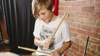 Could this young chap be a drumming star of the future?