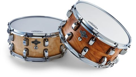 This snare (right) has a 15-ply birch shell topped with a veneer of rare elm burr