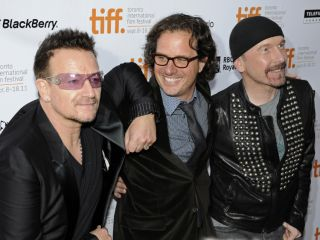 For Bono pictured with director Davis Guggenheim and The Edge it might get uncomfortable