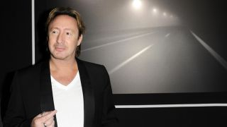 Julian Lennon, who is now balancing music with photography, stands before his shot titled Timeless.