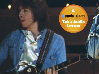 Taylor playing live with the Stones in 1973