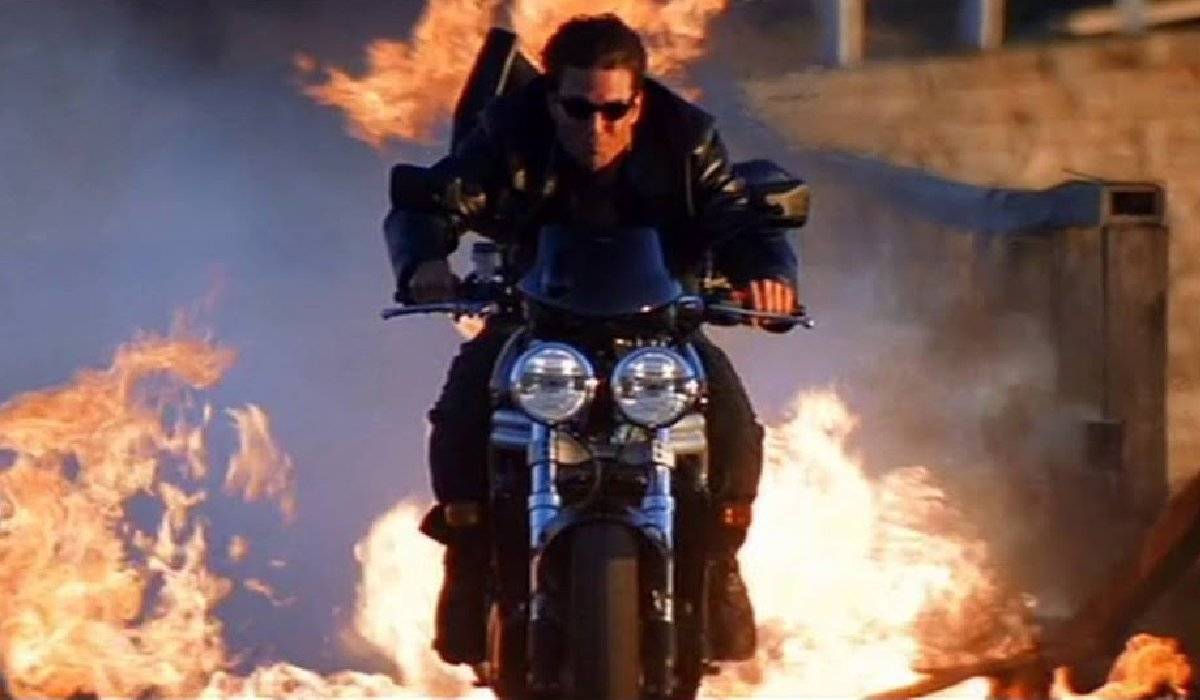 Mission: Impossible 2 Tom Cruise rides a motorcycle through fire