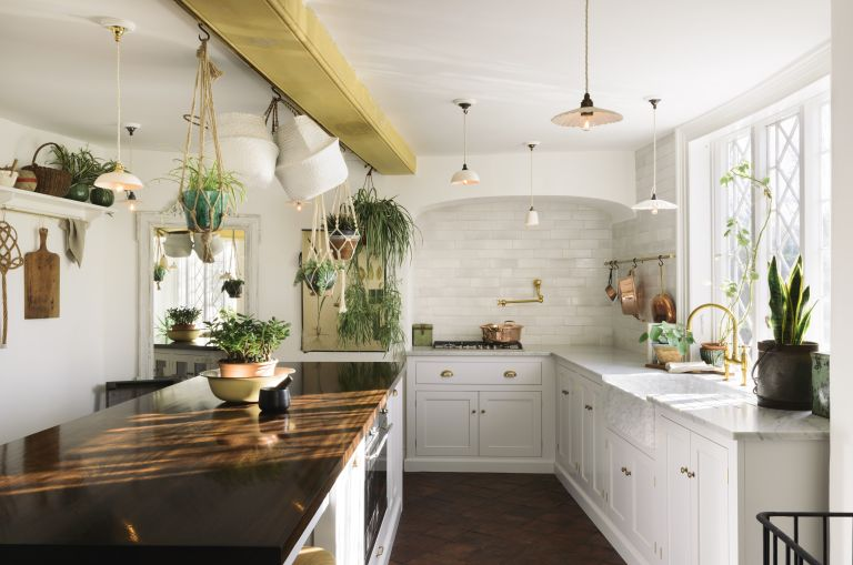 how to clean grout: white kitchen with metro tile wall and white cabinets and island by deVOL