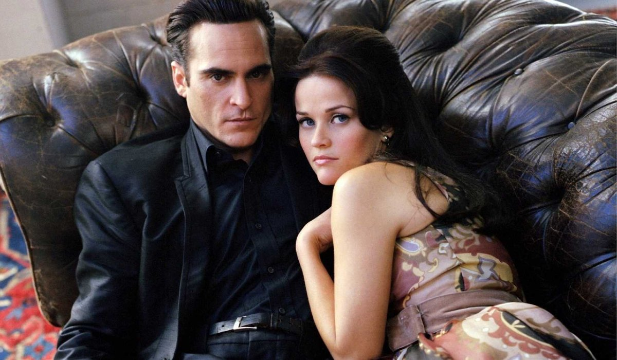 Walk The Line Joaquin Phoenix and Resse Witherspoon lie together on a couch