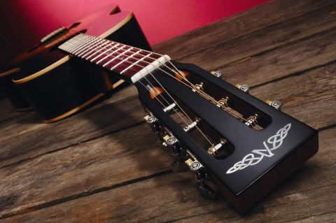 The S320A features a slot headstock.