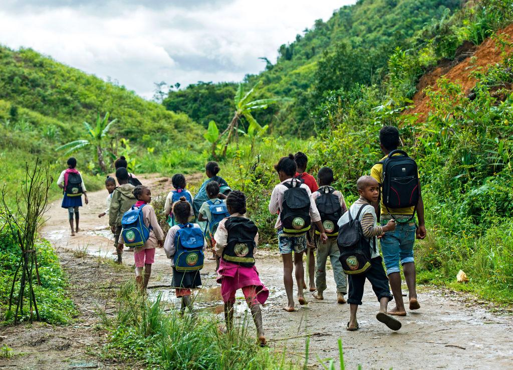 Children on the way to school, Betsimisaraka people ('the many inseparables'), the largest ethnic group on the eastern coast of Madagascar, Ambavaniasy, Madagascar.