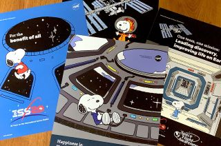 NASA's Space Flight Awareness program created four new Snoopy posters to promote safety and celebrate 20 years of humans on the International Space Station. CREDIT: