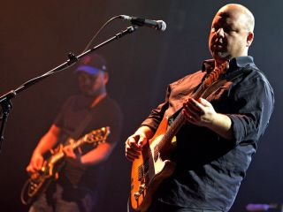Black Francis and Joey Santiago (left) and the other Pixies played their longest set ever last night