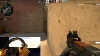 Guy playing Counterstrike with a steering wheel is somehow not the worst