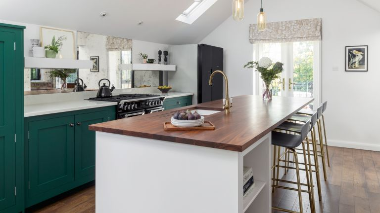 A ground floor extension gave Julie and James the chance to create their dream kitchen, with a vaulted ceiling and bold but sophisticated Shaker-style units