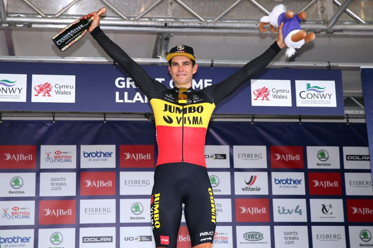 Wout van Aert on the Tour of Britain 2021 podium after winning stage four on the summit finish of the Great Orme in Llandudno, Wales