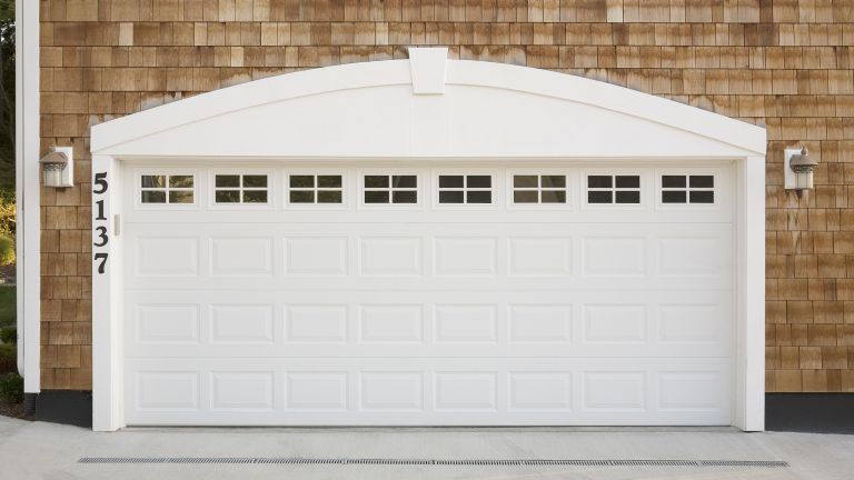 White garage door on a shingled home