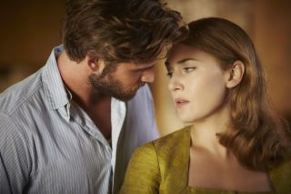 Liam Hemsworth and Kate Winslet get close
