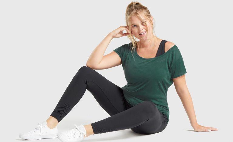 A model wearing the Gymshark Whitney Longline tee