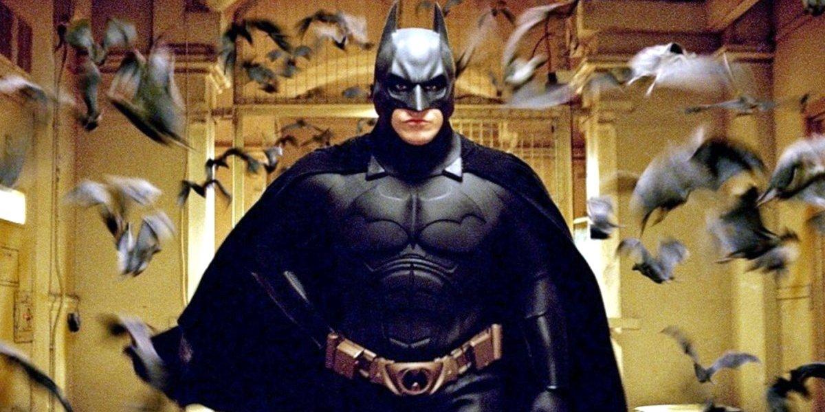 Batman Begins Batman walks through a cloud of holographic bats