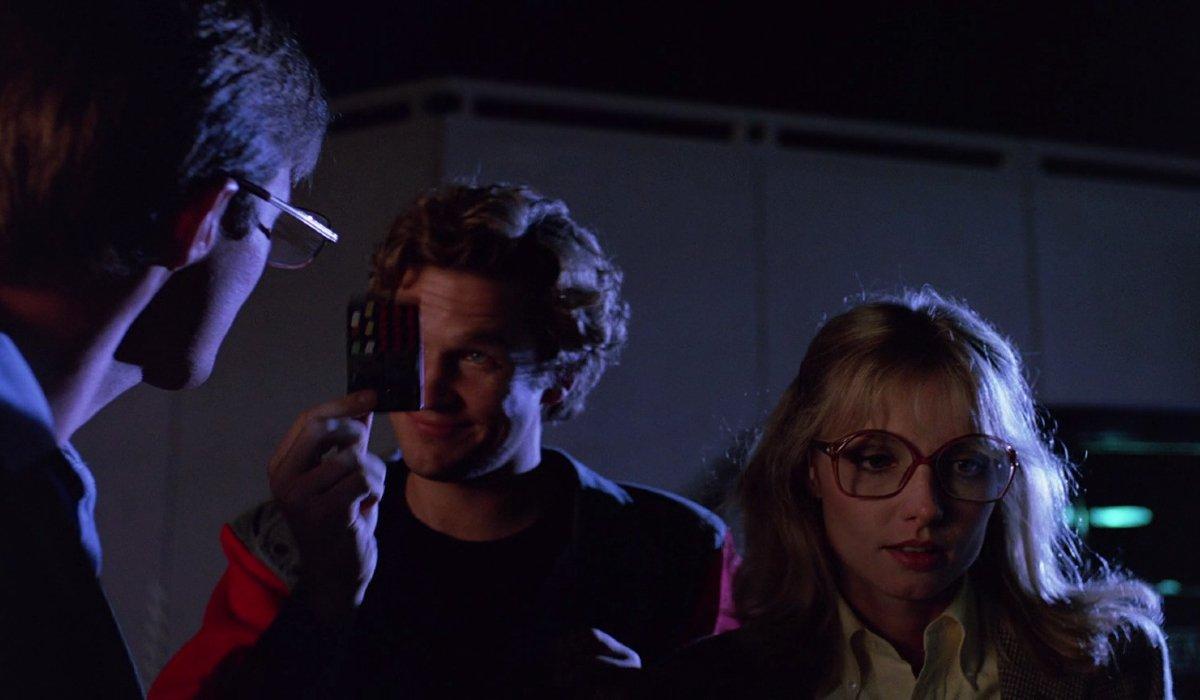Tron Alan Bradley, Kevin Flynn, and Lora Baines prepare to break into Encom